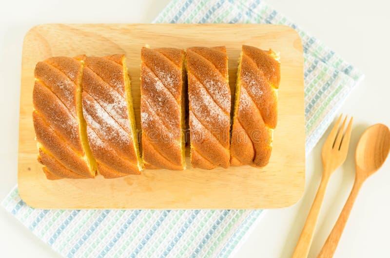 Jam Roll Cake. Slice Jam Roll Cake on Wood Plate stock photography