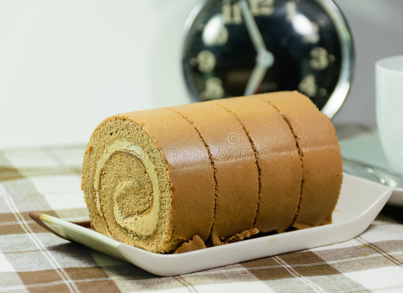 Jam roll. With clock stock photo
