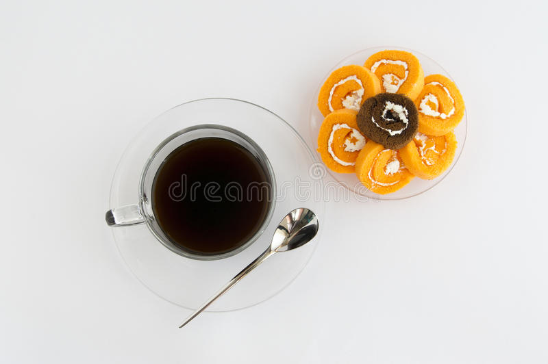 Jam roll with coffee. And spoon royalty free stock photo