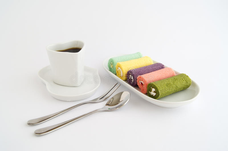 Jam roll with coffee. Spoon and fork stock images