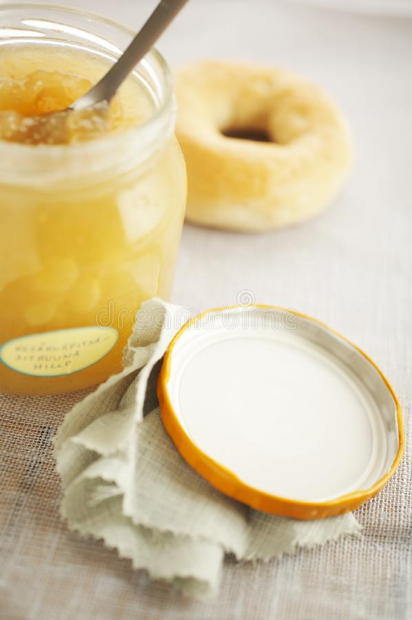 Jam and spoon royalty free stock photography