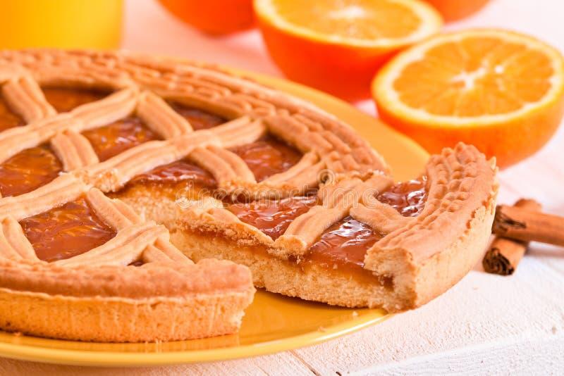 Jam tart. Jam tart with orange fruit on yellow dish stock image