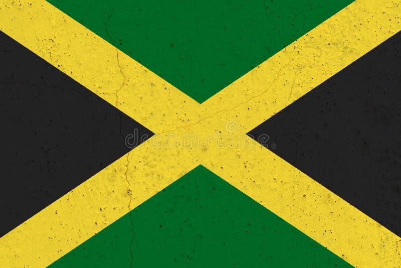 Jamaïca-vlag op concrete muur stock fotografie