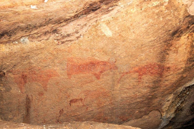 Jama obrazy na ścianie, malująca ocher skała prehistoryczny mężczyzna pierwotny neandertalczyk lider plemię szaman, p zdjęcie royalty free