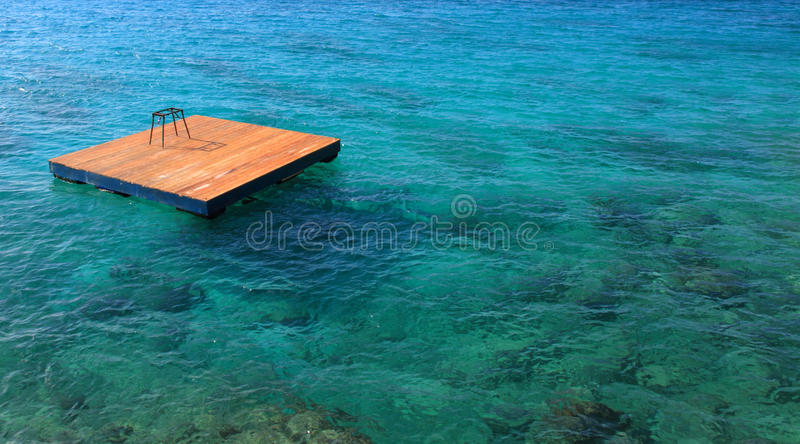 Jamaica, Caribbean sea. Quay in the middle of the Caribbean sea in Jamaica royalty free stock photo