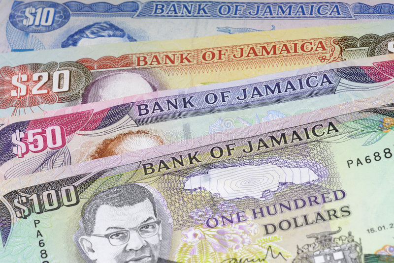 Jamaica Currency. Background with 10, 20, 50 and 100 Jamaica Currency royalty free stock image