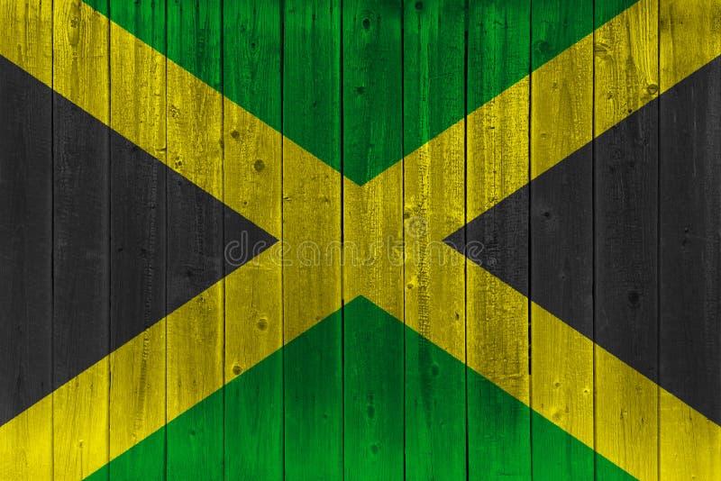 Jamaica flag painted on old wood plank. Patriotic background. National flag of Jamaica stock illustration