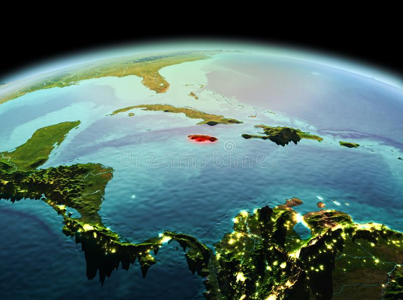 Jamaica on planet Earth in space. Morning above Jamaica highlighted in red on model of planet Earth in space. 3D illustration. Elements of this image furnished royalty free stock photo