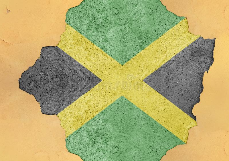 Jamaica state flag broken material facade structure in big concrete. Cracked hole royalty free stock photos