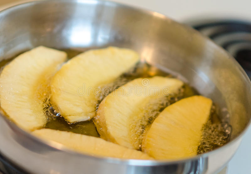 Jamaican fried breadfruit. Roasted fried breadfruit in frying pan on stove stock photography