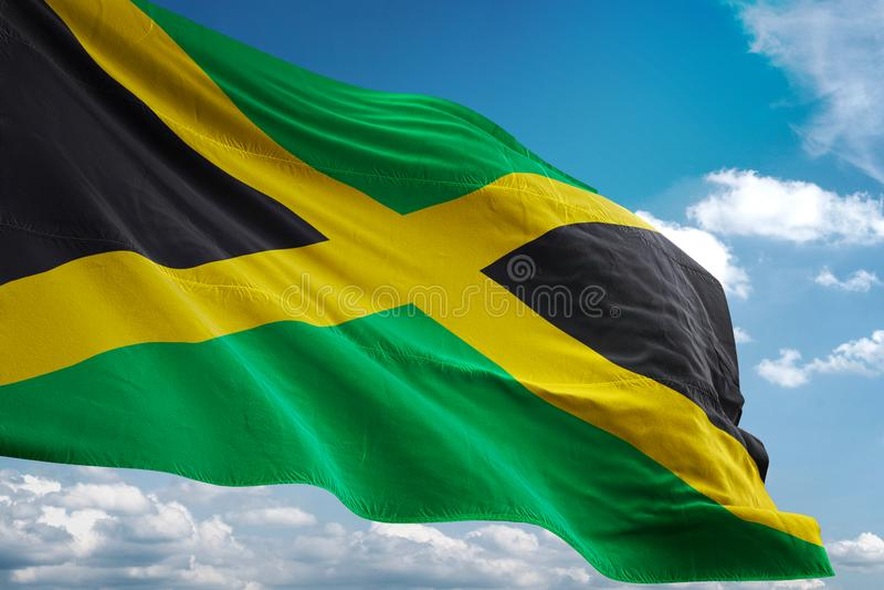 Jamaica national flag waving blue sky background realistic 3d illustration royalty free illustration
