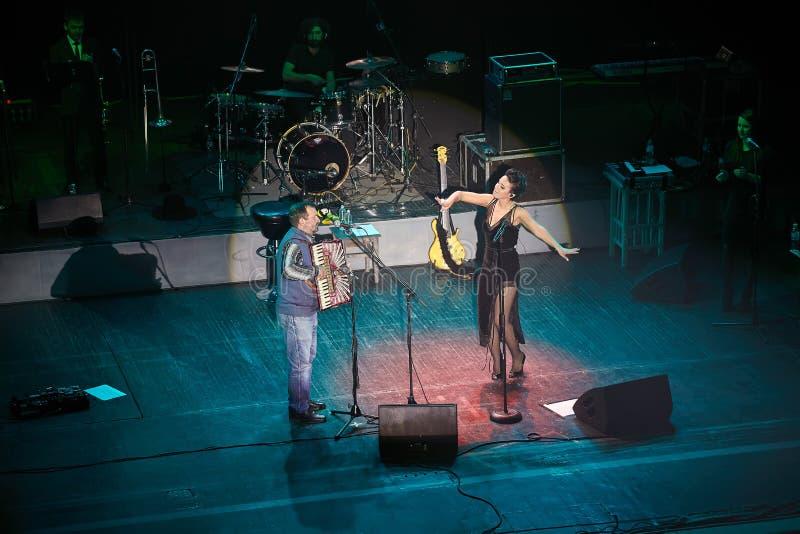 Jamala with father concert at Lviv Opera House. LVIV, UKRAINE - March 31, 2015: Ukrainian singer Jamala at solo concert at Lviv Opera House. Jamal won 61st stock photos