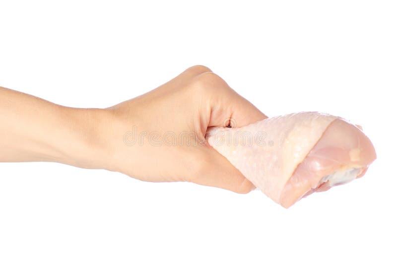 Jambe de poulet dans une main image libre de droits