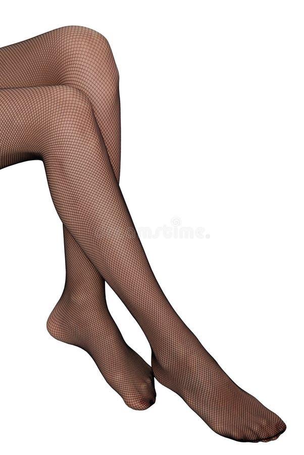 Jambes femelles minces images stock