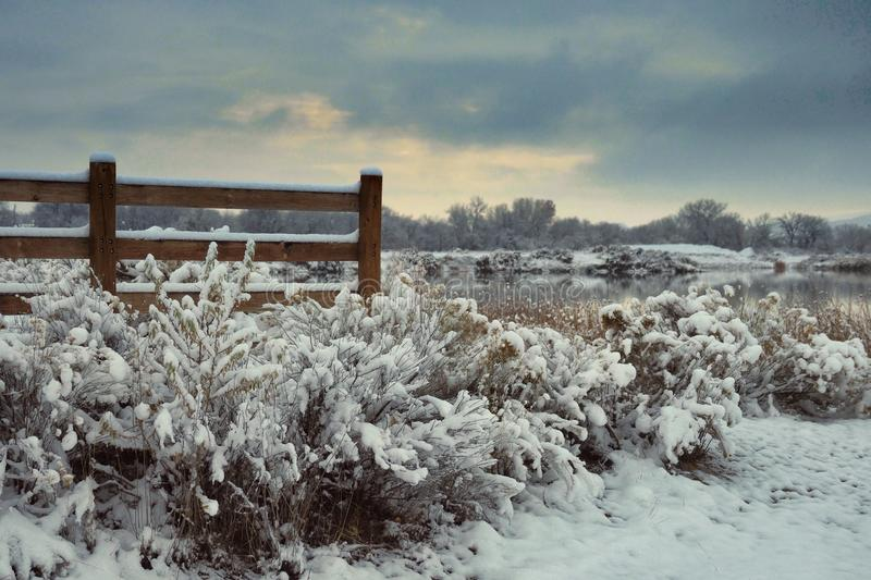 Fence and New Snow. James M. Robb Colorado River State Park in Fruita features events, camping, and fishing royalty free stock image