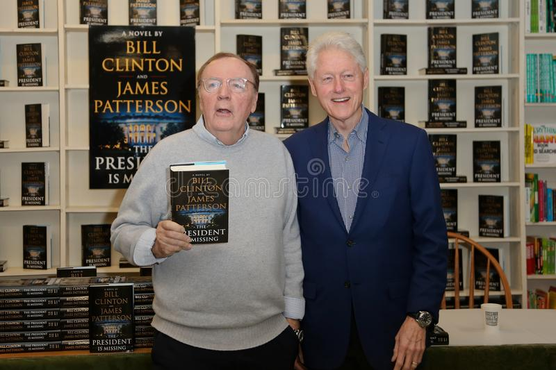 James Patterson, Bill Clinton. HUNTINGTON, NY - JUN 28: Author James Patterson L and former President Bill Clinton attend the book signing of `The President is royalty free stock image