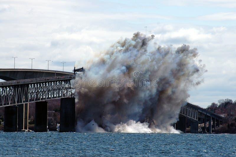 Jamestown Bridge is detonated. Debris that was the Jamestown Bridge splashes into Narragansett Bay royalty free stock photos