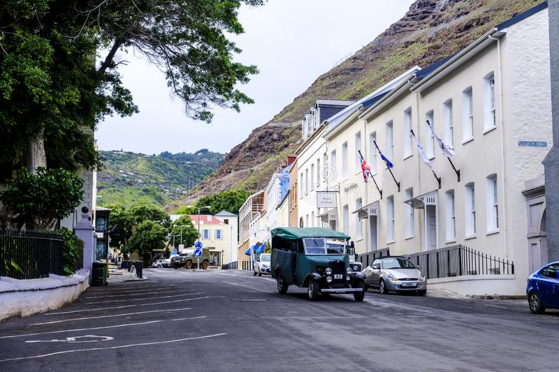 Jamestown Classic car St Helena. ST HELENA ISLAND, SOUTH ATLANTIC - APRIL 2 2018: Old classic car drives down picturesque Main Street St Helena past Mantis Hotel stock photos
