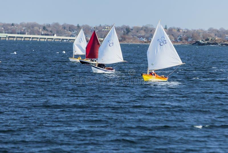 Line of small sailboats. Jamestown, Rhode Island, USA - January 12, 2008: Line of small sailboats in winter race off Jamestown stock images