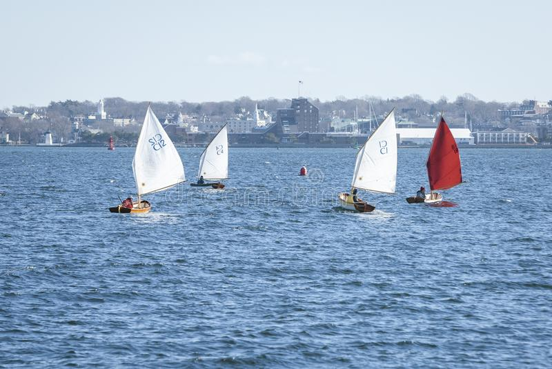 Chilly conditions for small sailboats racing in January. Jamestown, Rhode Island, USA - January 12, 2008: Small sailboats in winter race off Jamestown stock photos