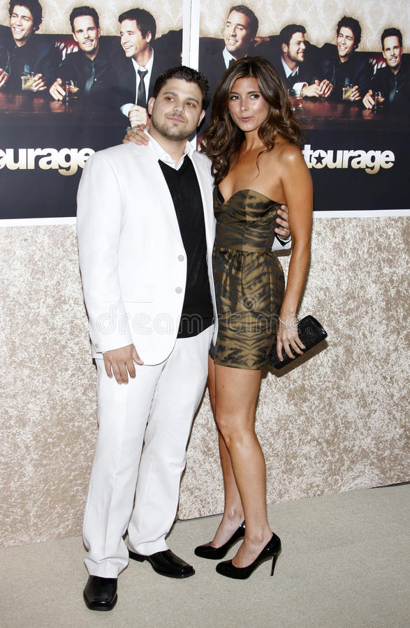 Jamie-Lynn Sigler and Jerry Ferrara. At the HBO`s Official Premiere of `Entourage` Season 6 held at the Paramount Pictures Studios in Hollywood, California royalty free stock photos