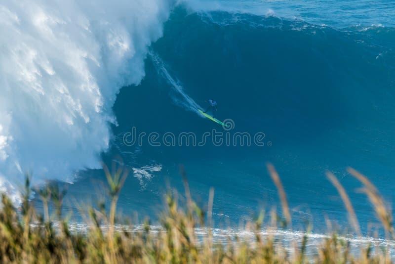 Jamie Mitchell AUS. NAZARE, PORTUGAL - DECEMBER 20, 2016: Jamie Mitchell AUS during the Nazare Challenge 2016 - Big Wave Tour #3 at Praia do Norte - Nazare stock photography