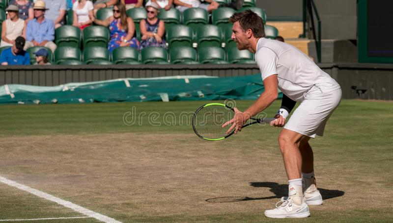 Jamie Murray playing the mixed doubles final on centre court, Wimbledon. stock photo