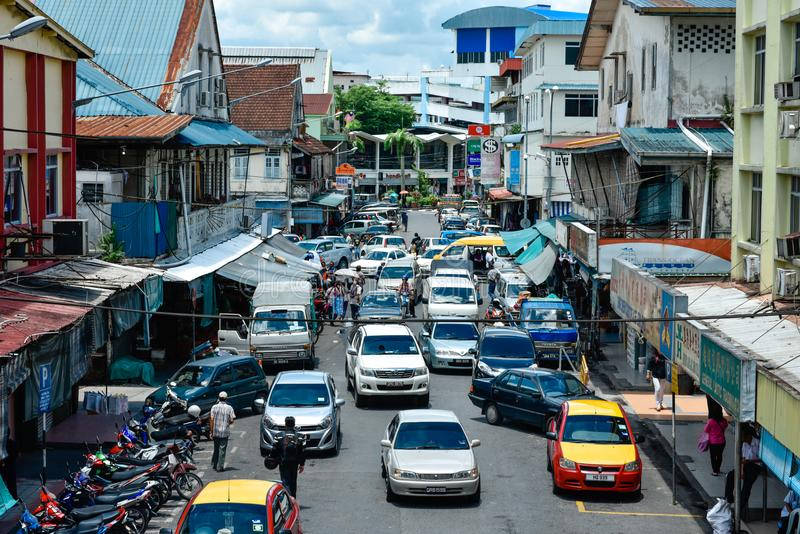Busy alley at downtown Sibu. Jammed alley at downtown Sibu with cars parked at the raodside stock images