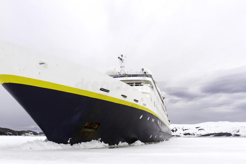 Jamming shelf ice, Antarctica. Passenger cruise ship jamming shelf ice in Antarctica royalty free stock images