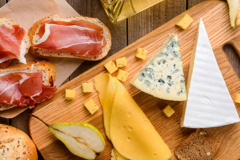 Jamon and assorted cheeses stock images