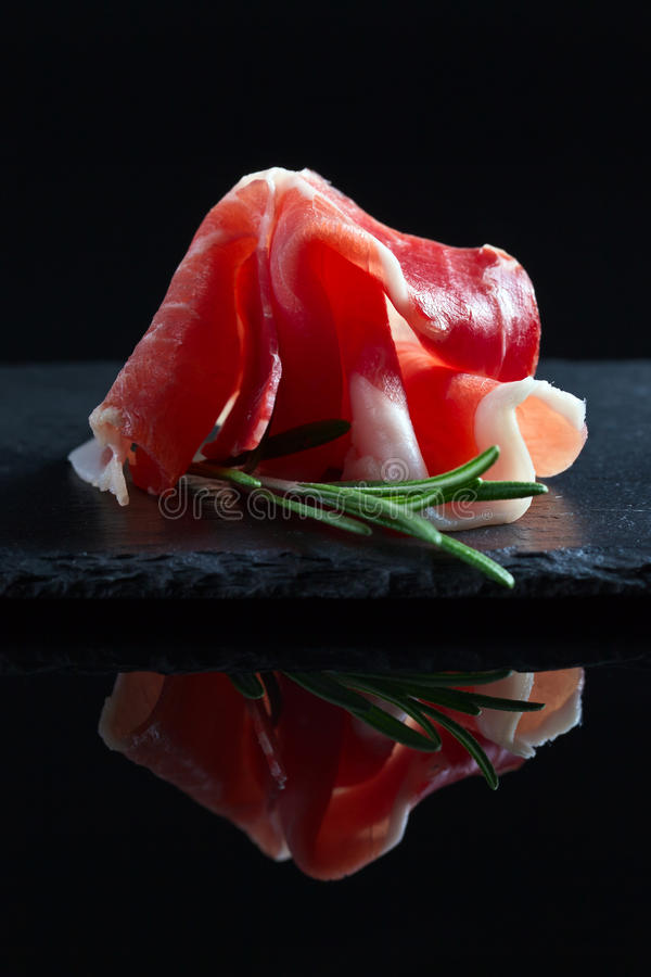 Jamon on a black background stock image