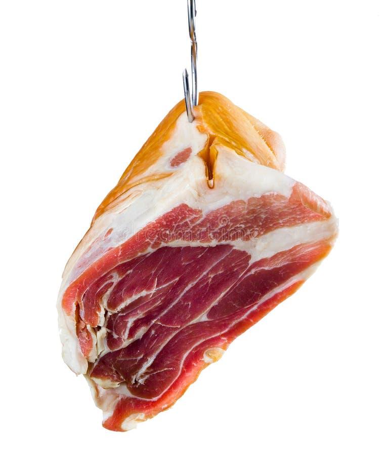 Jamon. La carne está colgando en el gancho. Aislado fotos de archivo libres de regalías