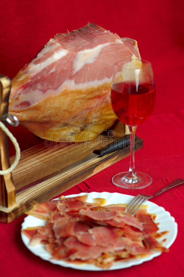 Jamon serrano. A Spanish ham over white stock image