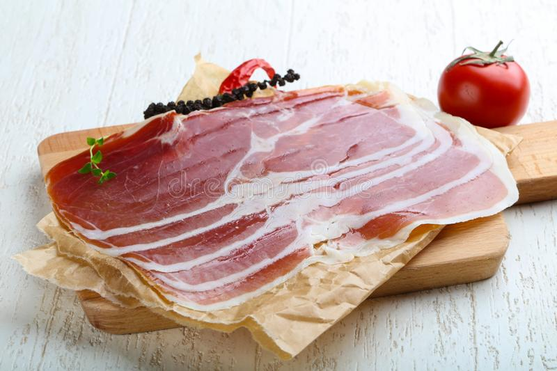 Jamon serrano. With pepper and thyme leaves royalty free stock photos
