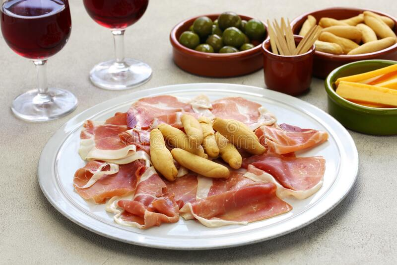 Jamon serrano with picos, spanish bar food stock photo