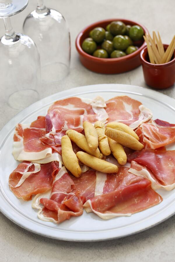 Jamon serrano with picos, spanish bar food royalty free stock image