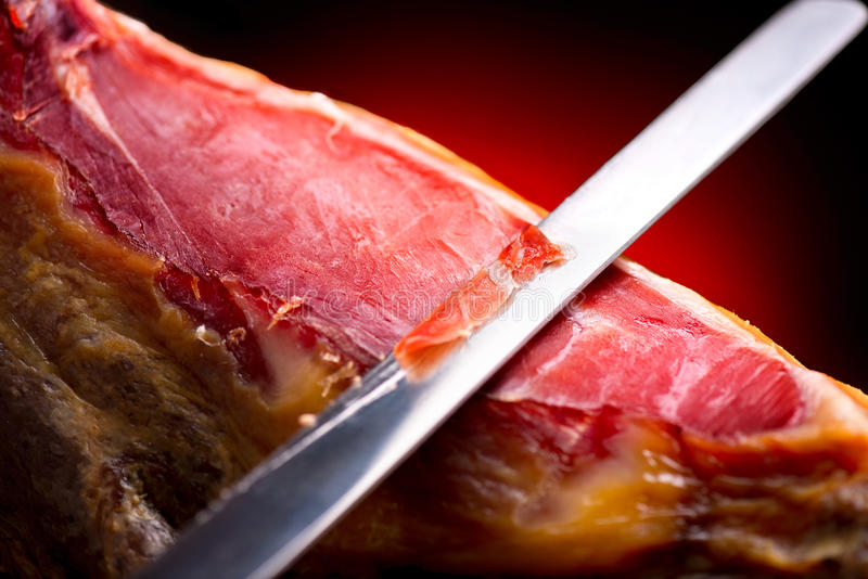 Jamon serrano. Slicing hamon iberico. Jamon serrano. Traditional spanish ham. Slicing hamon iberico royalty free stock photos