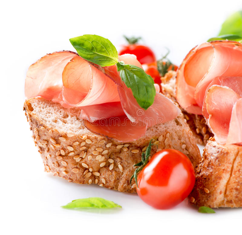 Jamon. Serrano Ham. Jamon. Slices of Bread with Spanish Serrano Ham over White royalty free stock image