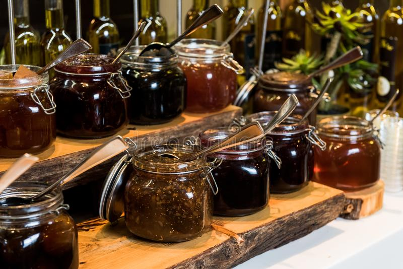 Jams in glass jars stock photos
