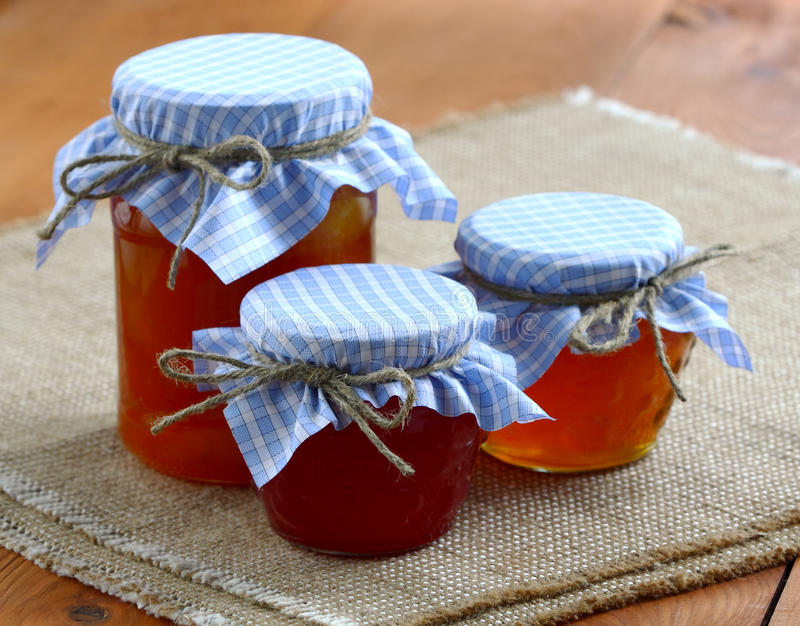 Jams and jellies in glass jars royalty free stock photos