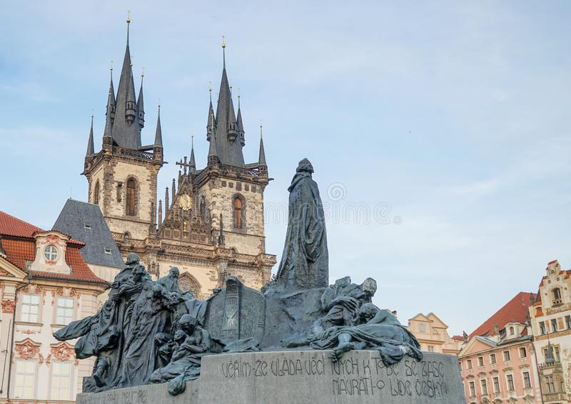 Jan Hus Monument on the Old Town Square in Prague. Jan Hus Monument on Old Town Square in Prague with magnificent town houses and church stock photo
