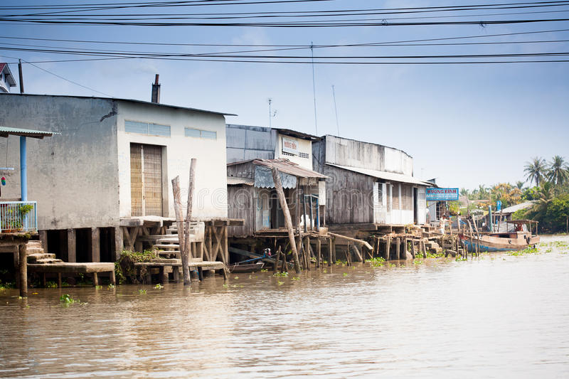JAN 28 2014 - MY THO, VIETNAM - Houses by a river, on JAN 28, 2. 014, in Mekong Delta, Vietnam royalty free stock photography