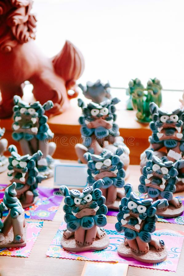 Ceramic Shisa lion guardian model in souvenir shop, Naha, Okinawa. JAN 28, 2013 Naha, Okinawa, JAPAN : Ceramic Shisa lion guardian model sculptures in vintage royalty free stock photo