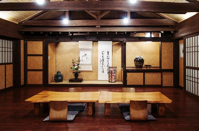Japanese Okinawa style room solid wood table and paper door, and stock photography