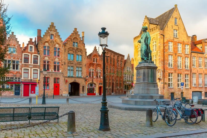 Jan Van Eyck Square in Bruges, Belgium. Monument of famous artist Jan Van Eyck on Square Jan van Eyckplein in Bruges, Belgium stock photo