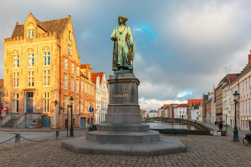 Jan Van Eyck Square and Spiegel in Bruges, Belgium. Monument of famous artist Jan Van Eyck on Square Jan van Eyckplein in Bruges, Belgium stock photo