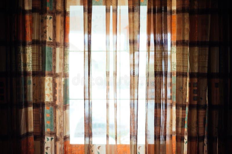 A janela brilhante com colorido drapeja fotografia de stock