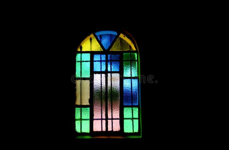 Janela de cores diferentes no fim escuro acima fotografia de stock