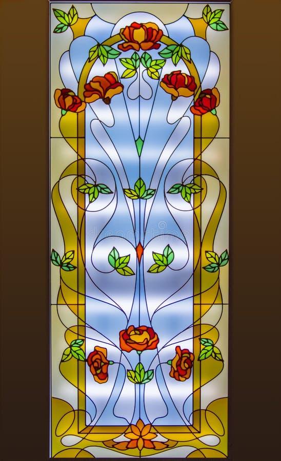 Janela de vidro colorido com teste padrão floral imagem de stock