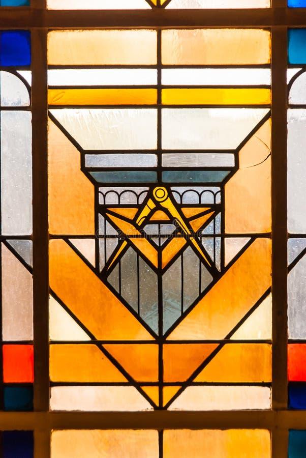 Janela de vitral do símbolo do freemason do círculo e do anjo imagem de stock